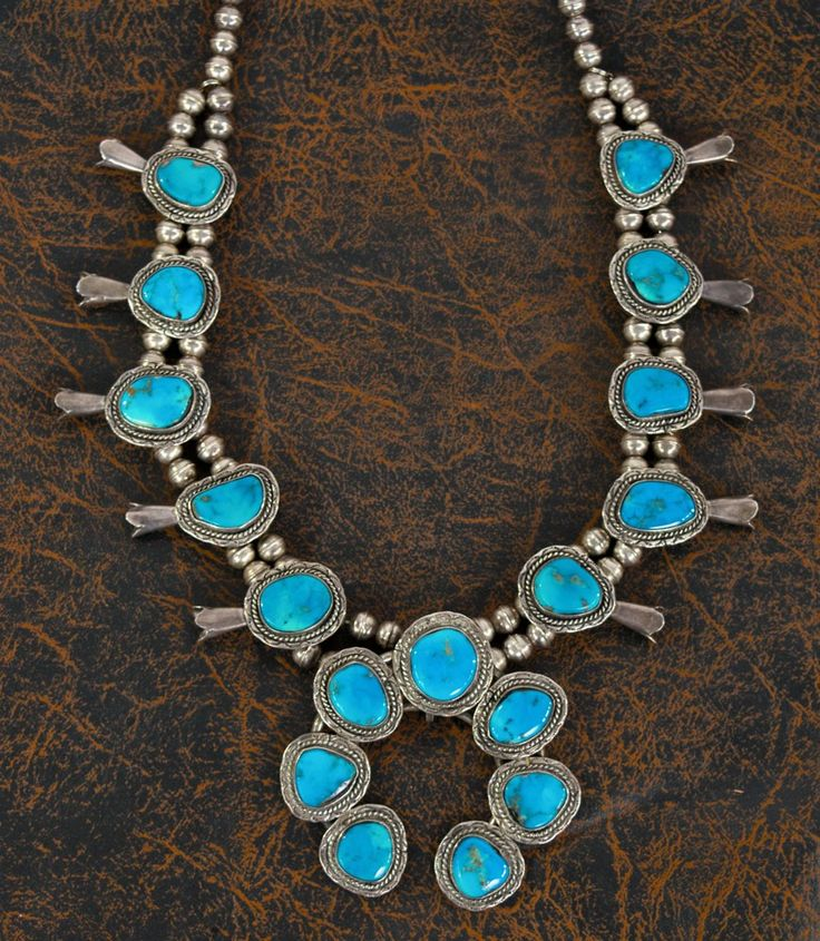Teskey's Saddle Shop: Sterling Silver, Navajo Pearl and Genuine Turquoise Squash Blossom