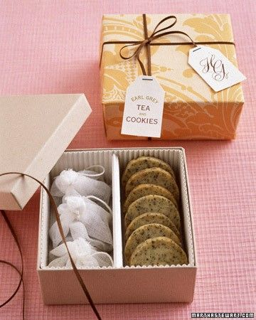 Tea is twice as nice coupled with cookies flavored the same way. These Earl Grey tea cookies were made by mixing tea leaves into shortbread batter. Customize a box with corrugated paper to form sections for cookies and tea bags, and wrap with damask paper and ribbon.