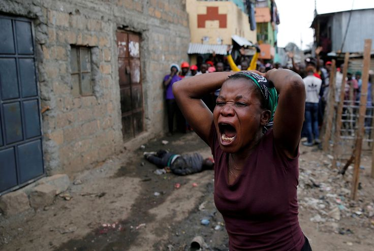 A woman gestures as she mourns the death of a protester in Mathare, Nairobi, Kenya, on August 9, 2017. Supporters of opposition leader Raila Odinga were protesting an election, alleging vote-rigging, and clashed with police in several locations.