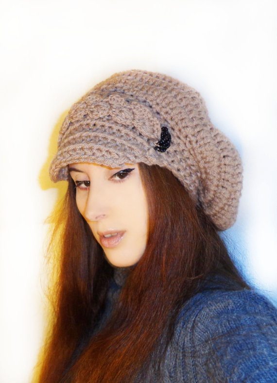 Handmade newsboy slouchy crochet hat from wool blend yarn, very soft, comfortable and warm.  The color is that of caramel, or light cacao.  I add black glass beads on the sides, something different than other hats and beautiful.    Fits all sizes    Hand wash in cold water and lay flat to dry for best care.    Plus with each item purchase i will give a small gift!