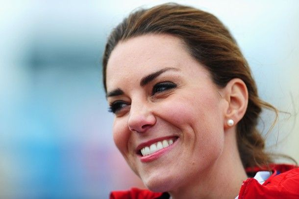WEYMOUTH, ENGLAND - AUGUST 06:  Catherine, Duchess of Cambridge shares a joke with members of the Team GB sailing squad on Day 10 of the London 2012 Olympic Games at the Weymouth & Portland Venue at Weymouth Harbour on August 6, 2012 in Weymouth, England.