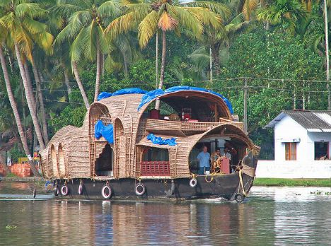 In the Indian state of Kerala, beautiful houseboats with thatched roofs are a common sight floating on the water. Many of these luxury houseboats are open to tourists, who can come onboard and relax while enjoying a freshly cooked meal from the boat's kitchen.