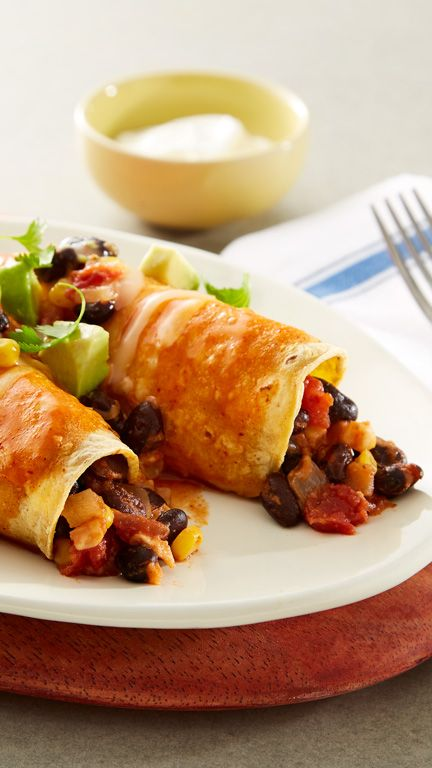 Loaded with black beans, corn and cheese, these meatless enchiladas are easy to make and always satisfy hearty appetites.