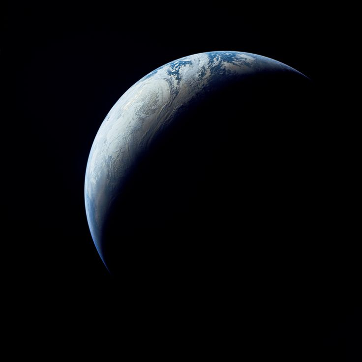 Earth as viewed from 10,000 miles. This photograph was made when the Apollo 4 spacecraft, still attached to the S-IVB (third) stage, was orbiting Earth at an altitude of 9,544 miles.