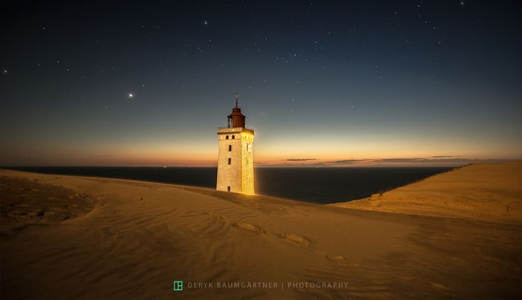 [ desert lighthouse ] - This is not photoshopped - it's a real scene in the northern part of Denmark where Europe's largest shifting sand dune destroying farmhouses, churches, roads and anything else that gets in its way. Rubjerg Knude lighthouse is expected to crash into the sea in about 5 years ...