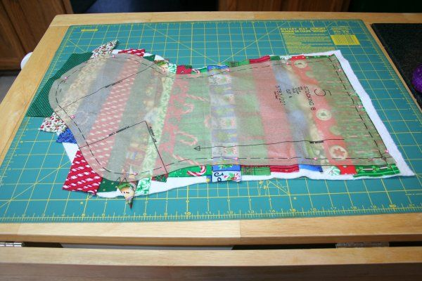 Pin pattern piece over scrappy quilt piecing then cut out stocking. Quick and easy.