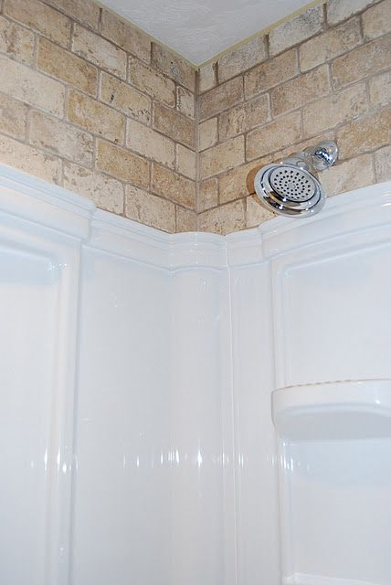 Here is a fun way to have the illusion of a Full tiled shower. By only tiling the upper part of the wall and using a more cost efficient insert. you get a high price upscale look for pennies compared!!
