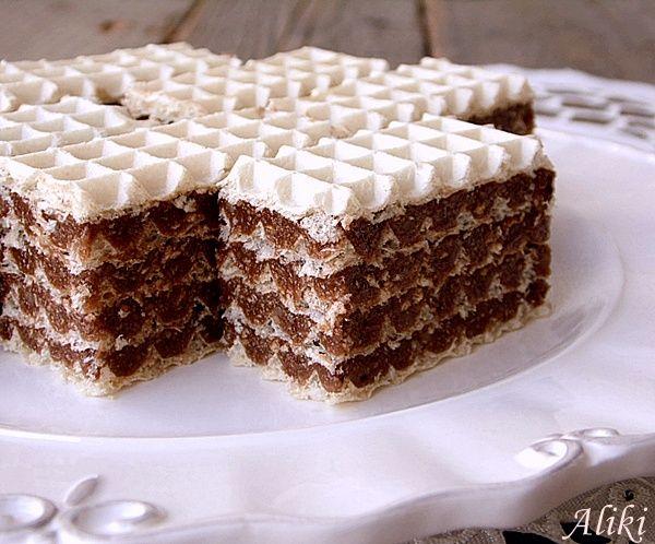 Sastojci   1 pakovanje oblatni 28x28 cm.   6 jaja  300 g. šećera  2 vanilin šećera  150 g. čokolade za kuvanje  250 g. maslaca ili margari...