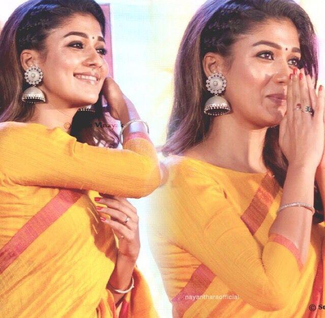 Nayanthara yellow Saree. Gorgeous big silver earrings.