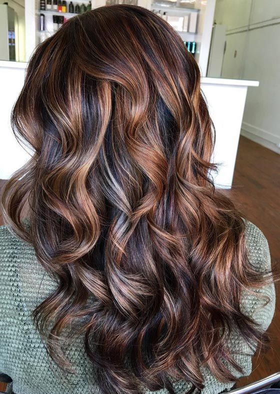 Mahogany. The word itself sounds opulent, luxurious, exotic. This rich and vibrant color that is a shade between red and brown is one of the most popular hair colors around the world.