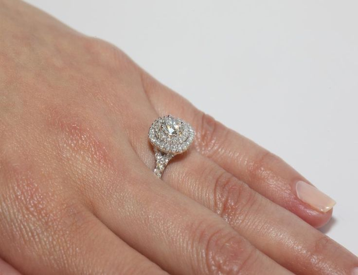 This 14k white gold diamond split shank double halo pave engagement ring is available exclusively from JamesAllen.com