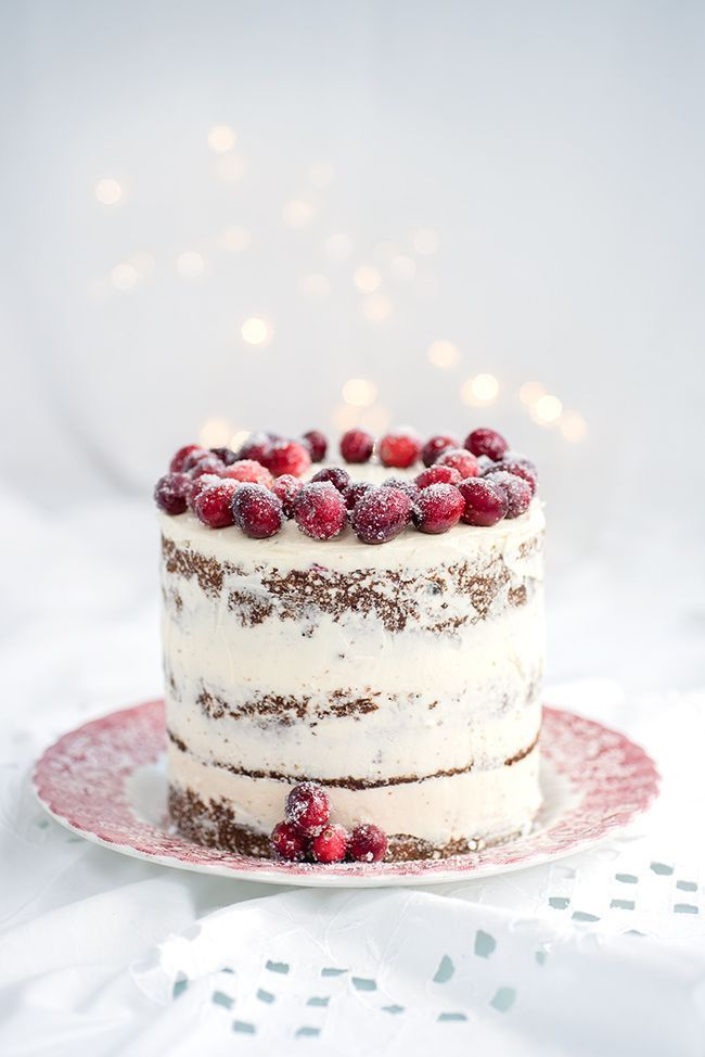 Cranberry, orange, and walnut festive cake with sugared cranberries on top!