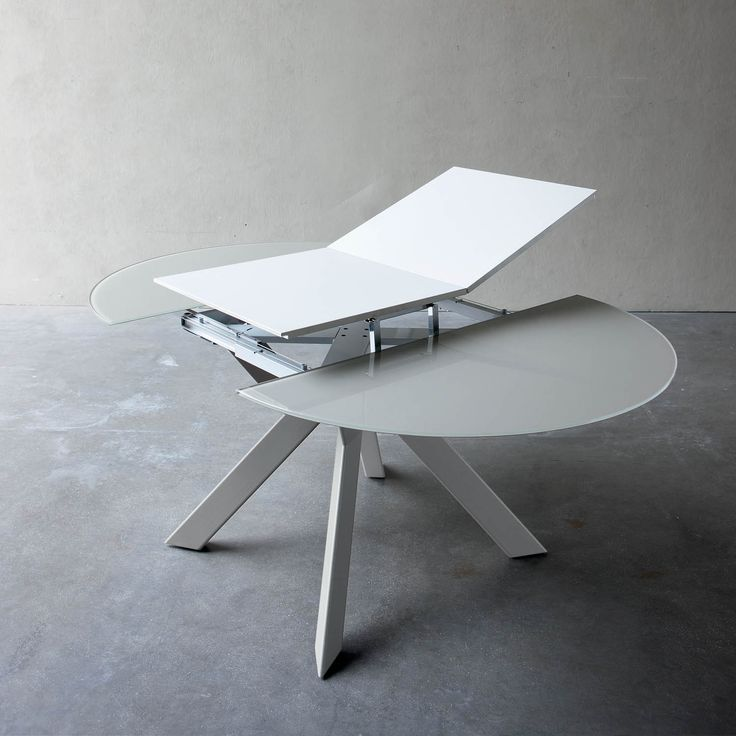 Round extending dining table with metal grey or white legs and extra w at My Italian Living Ltd