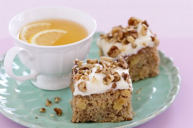 Smothered in cream cheese and chopped walnuts, this banana and pineapple spice cake is a Southern favourite.