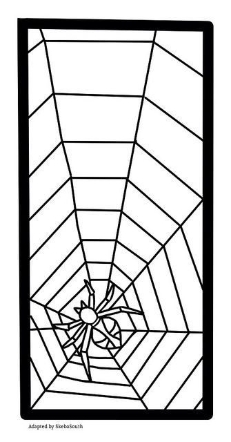 Stained glass pattern of a web and spider for Halloween.