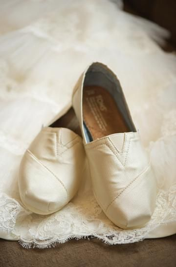 Toms Wedding Collection are perfect dancing shoes to change into at your reception. For every pair of Toms you buy, you gift a pair of shoes to someone in need! Photo by Sara Donaldson #wedding #shoes #toms