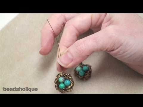 How to Make a Wire Bird's Nest Pendant.  This is the tutorial that our craft leader used to make necklaces with 17 tweens (2 adults, 17 9-12 yr olds) in less than 45 minutes!  People keep asking the kids where they bought them.