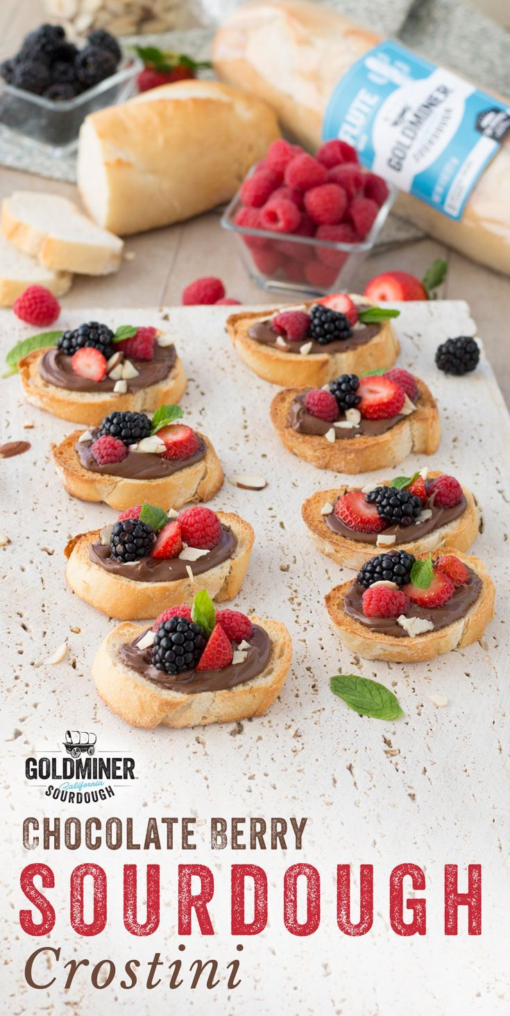 Chocolate Berry Sourdough Crostini: Tangy meets sweet for the perfect Valentine treat. Top slices of California Goldminer Sourdough Flute Bread with chocolate hazelnut spread, fresh raspberries, blackberries, strawberries, mint and shaved almonds, and sha
