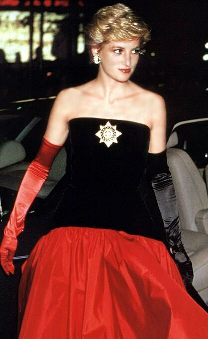 Strapless ball gown designed by Murray Arbeid on several occasions. The Princess accessorized this dress with one red glove, one black glove and a Maltese cross brooch...