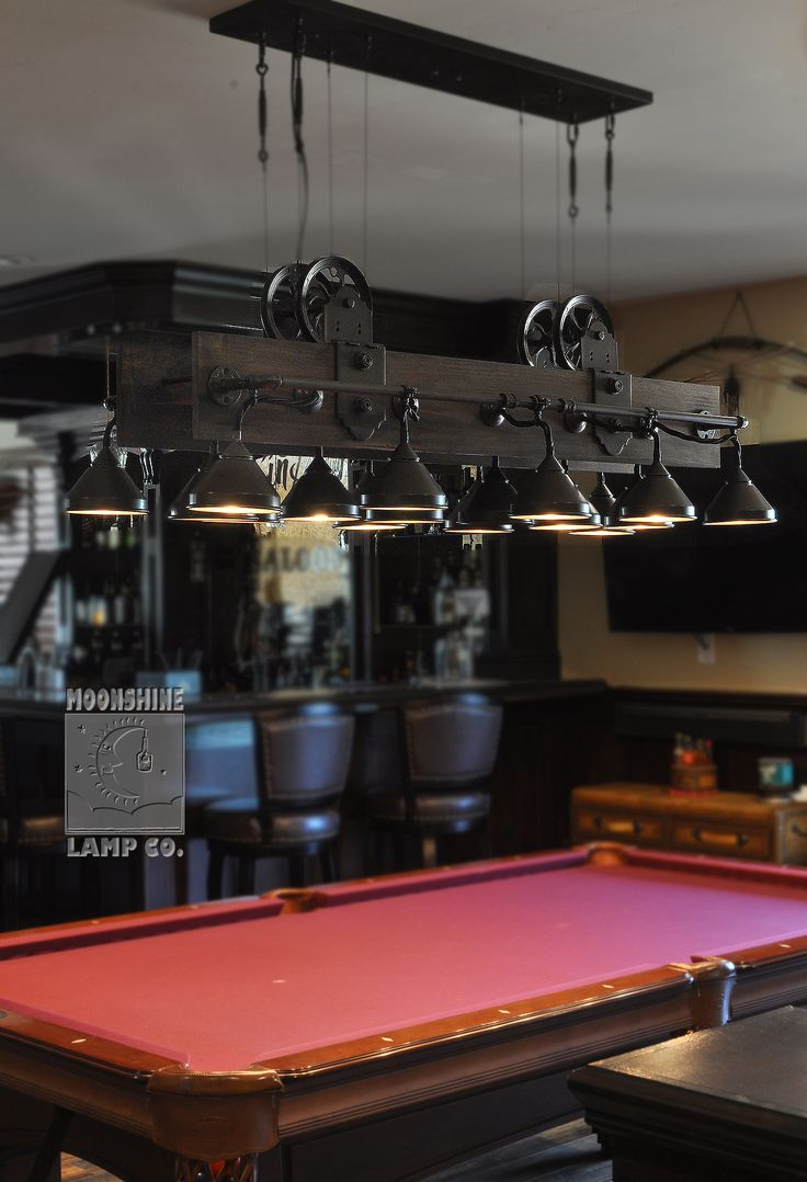 Lots of detail in this amazing pool table light made out of steel funnels, water pipe and pulley wheels.  Definitely one of our more intense custom jobs.