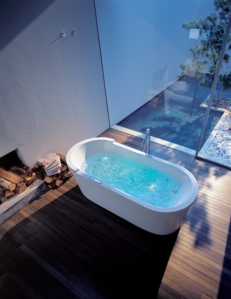 bathroom! (the huge window! the wooden floor! firewood in the bath? cool. view of the garden!) Duravit tub designed by Starck.