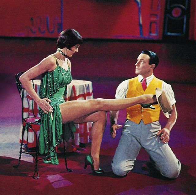 """Cyd Charisse and Gene Kelly in the """"Broadway Melody"""" ballet from """"Singin' in the Rain.""""  Charisse was popularly considered to have the best legs in Hollywood.  She wasn't a shabby dancer, either.  Neither was Kelly, for that matter."""