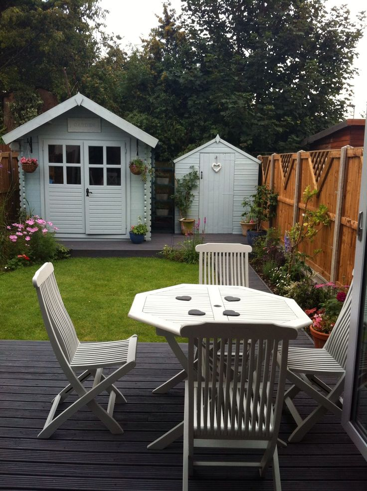 Old garden table and chairs up cycled in Homebase garden colour Silver lining. Decking Cuprinol Silver Copse and summerhouse in Sadolin's Marie's bird table