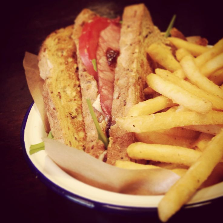 Bacon, Brie and onion chutney sandwich with herb fries.