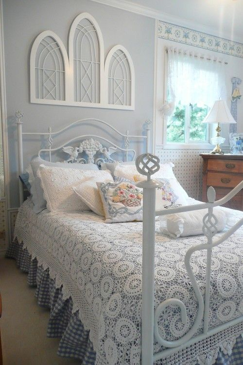 Lace Spread and Vintage Stained Glass Windows above the Bed.