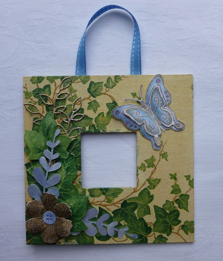 Butterfly Napkin MDF hanging plaque. - Imagination Craft's - Butterfly stamp set. Cream MDF paint.  Blue mica powder. Ivy leaf paper napkin. Gold embossing powder. Various dies and pink glitter.  August 2013.