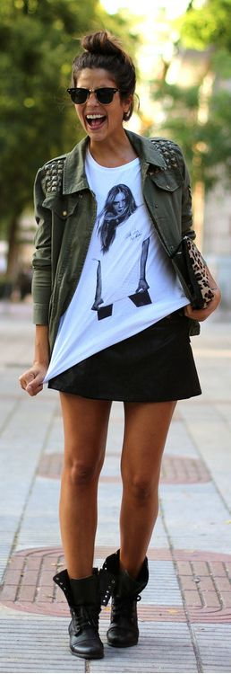 Cute skirt with combat boots, love the army green jacket.... Can I