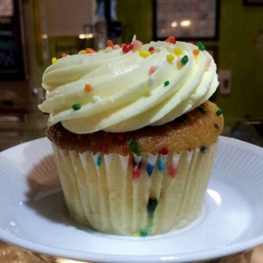 Vanilla sprinkled cupcakes for Easter or whenever! #felicitouscoffee in Tampa, Fl
