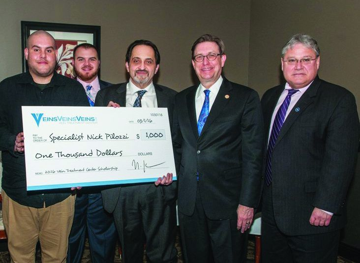 Decorated Veteran is First to Receive New Daemen Scholarship. Nicholas Pilozzi, Chris Morton '13, Dr. Hratch Karamanoukian, Daemen President Gary A. Olson, and Dr. Michael Brogan, vice president for academic affairs and dean of the college.