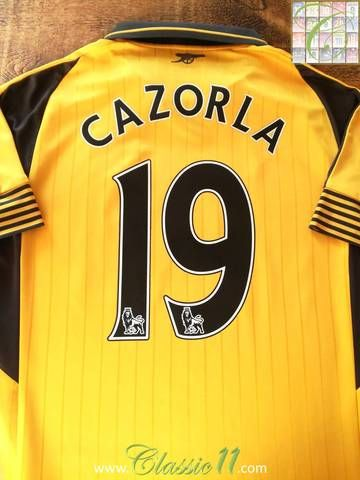 Official Puma Arsenal away football shirt from the 2016/17 season. Complete with Cazorla #19 on the back of the shirt in Premier League lettering.
