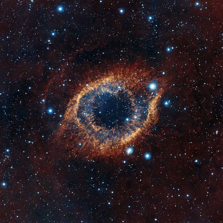 ESO's Visible and Infrared Survey Telescope for Astronomy (VISTA) has captured this unusual view of the Helix Nebula (NGC 7293), a planetary nebula located 700 light-years away. The coloured picture was created from images taken through Y, J and K infrared filters. While bringing to light a rich background of stars and galaxies, the telescope's infrared vision also reveals strands of cold nebular gas that are mostly obscured in visible images of the Helix.