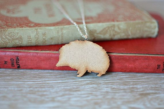 Wooden Hedgehog Necklace. A delightful handmade hedgehog necklace, with silver plated chain and findings.   https://www.etsy.com/uk/listing/229086426/wooden-hedgehog-necklace-natural-laser?ref=shop_home_active_7