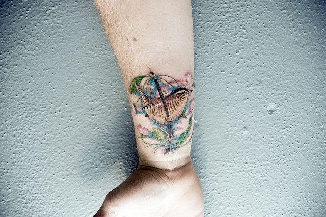 wren-bird-at-tree-stalk-tattoo-on-wrist.jpg (640×426)