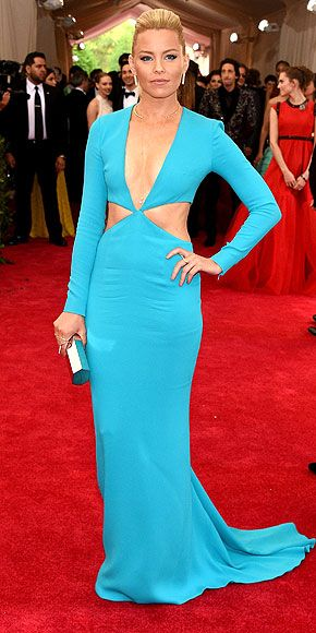 The Most Jaw-Dropping Dresses at the 2015 Met Gala | ELIZABETH BANKS | in an electric-blue Michael Kors cutout gown with an open choker featuring two dangling pearls and a high-shine box clutch.