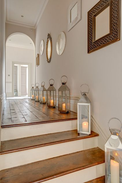 Lining the hallway with lanterns and battery operated candles would be beautiful for the holidays; esp. Christmas. I would also add a touch of greenery and red bows tied to the top of the lanterns.