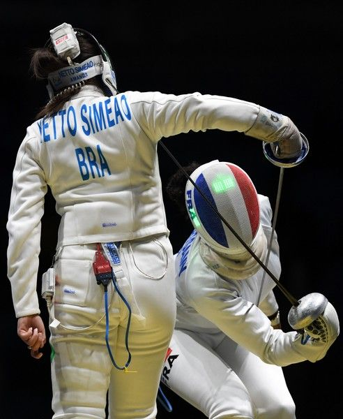 Brazil's Amanda Netto Simeao (L) competes against France's Marie-Florence Candassamy during their womens individual epee qualifying bout as part of the fencing event of the Rio 2016 Olympic Games, on August 6, 2016, at the Carioca Arena 3, in Rio de Janeiro.. / AFP / Kirill KUDRYAVTSEV