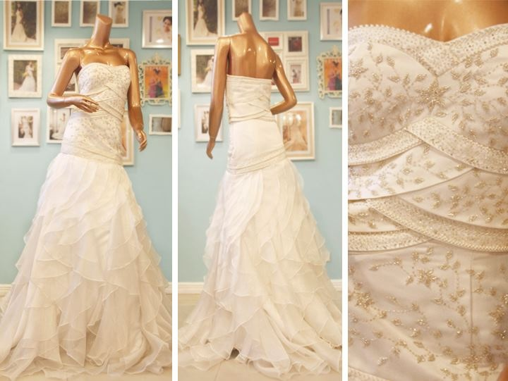 Beaded Camille Garcia Wedding dress with a drop waist and ruffle skirt.