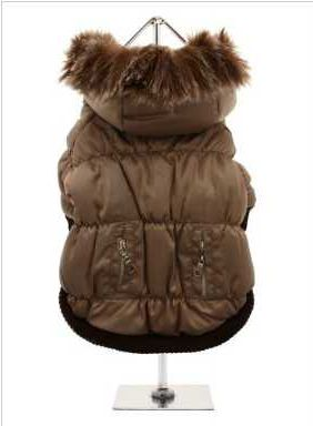 Introducing our premium range of quilted coats. This is a luxuriously quilted Parka Coat with a faux trimmed detachable hood. It gives your dog two styles in one; wear it as a parka or, when the hood is removed, it can be worn as a coat. The arms and hem are elasticised for a great fit. It fastens from the underside with three pop-on pop-off chrome buttons and the inside is lined with a light brown fleece material. There are two pockets on the back which can be opened and closed with two…