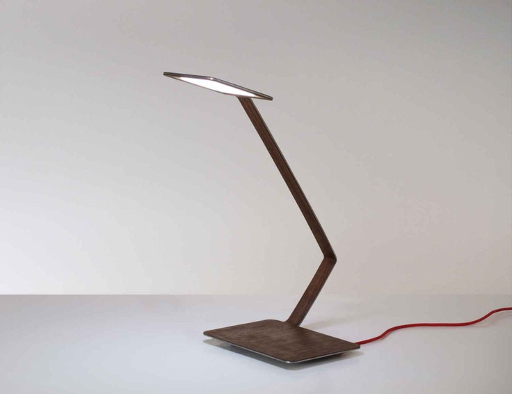 The Profilo table lamp uses OLED technology.  The project highlights the extreme thinness using an aluminum sheet with a thickness of 3 mm, veneer and curved. The result is a lamp ethereal, by the thin profile.