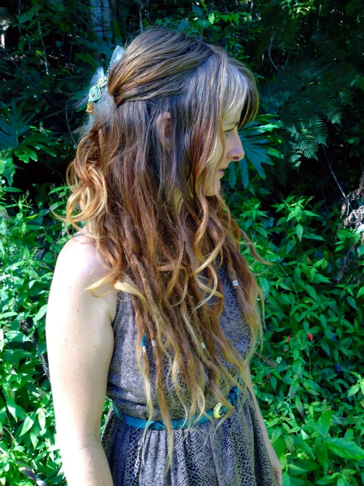 Loose curls and dreads underneath. Love this combination.