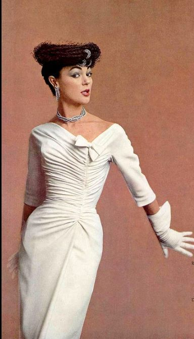 Ivy Nicholson wearing a rayon crêpe cocktail dress by Jacques Fath, 1956. Photo by Jacques Decaux.
