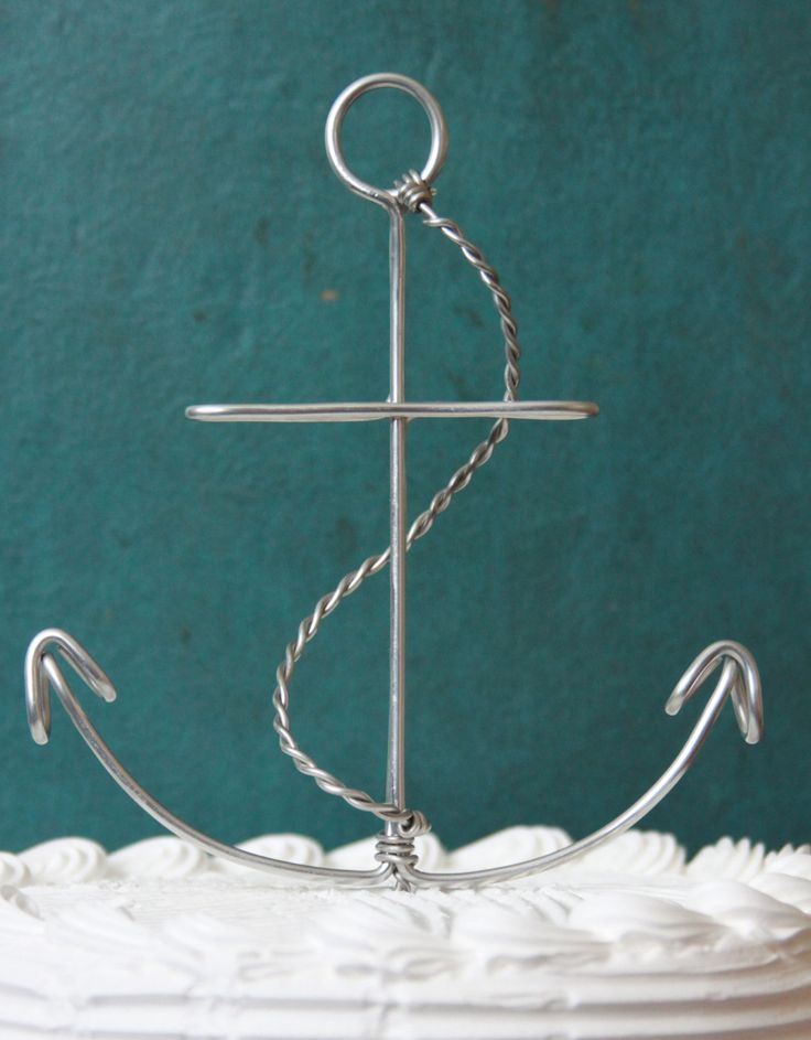 Anchor Wedding Cake Topper would be cute with bride and groom sitting on the hooks on either side.