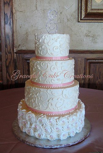 Elegant Ivory Butter Cream Wedding Cake with Piped Rosettes and Rose Pink Accents