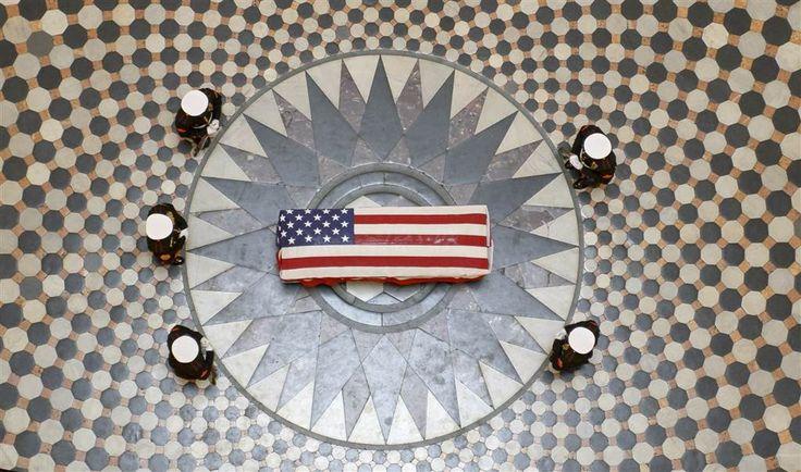 Astronaut John Glenn lying in state at US Capitol.