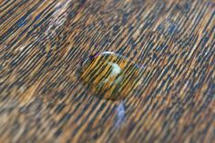 Wood is a natural material that absorbs stains. When an oily substance comes in contact with your wooden table, the grease stains the surface before it soaks into the wood. To effectively remove an oil stain from your wood table, you must remove the grease from below the surface as well. Oil left in the wood causes discoloration and, depending upon...