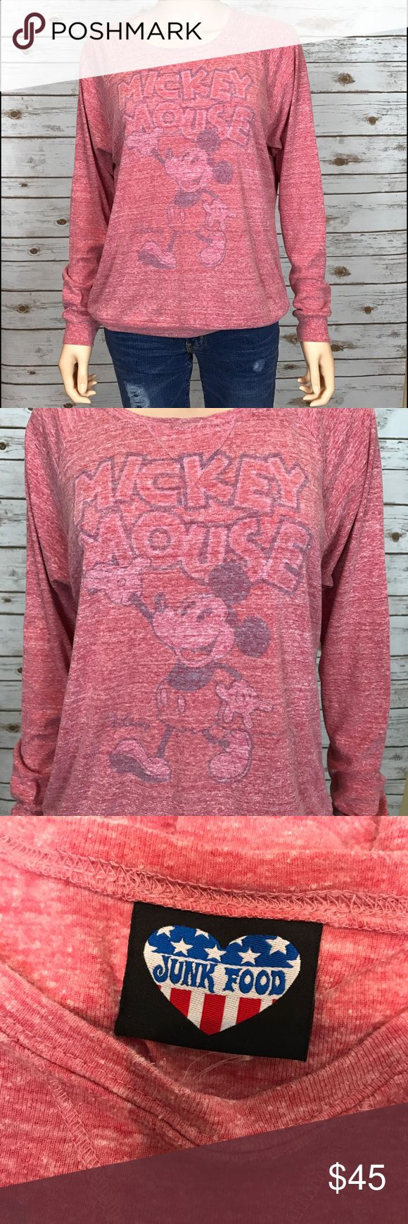 Junk Food Mickey Mouse Sweatshirt Sz. M This is a size medium Junk Food Mickey Mouse sweatshirt. The color is a mix between a light red and light pink. It was made to look kind of distressed and heathered, with the graphics slightly faded. It's not from wear. I wore this one time in Disneyland. It looks brand new. It's honestly good for any time of the year. It is not a super thin sweatshirt, but also not very thick. It can be worn by itself with jeans and cute boots or sneakers or it can be…